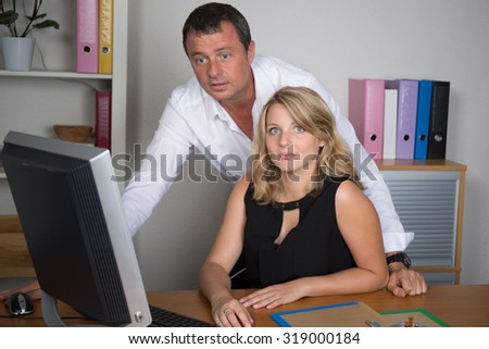 Male handsome manager with her secretary at office