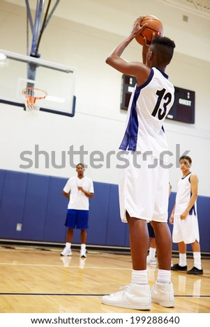 Male High School Basketball Player Shooting Penalty - stock photo