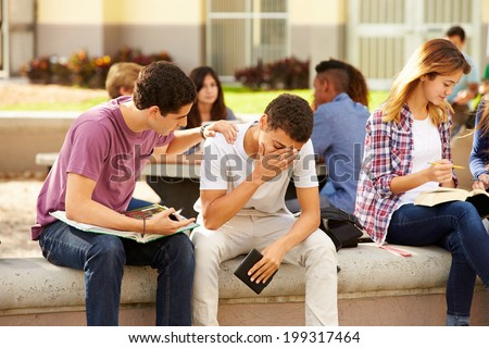 Male High School Student Comforting Unhappy Friend - stock photo