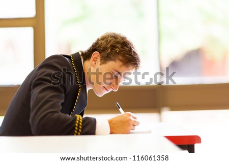 male high school student in classroom - stock photo