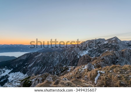 Male hiker at the top of the mountain at sunset