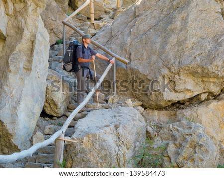 Male hiker trekking in the Crimea mountains