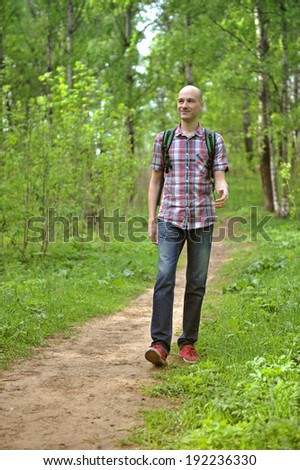 Male hiker walking in forest.
