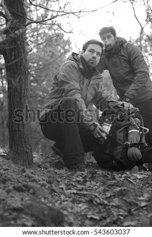Male hikers looking away in forest