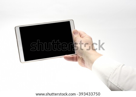 Male holding Touch Screen with dark screen - stock photo