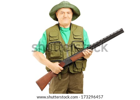 Male hunter holding a rifle isolated on white background