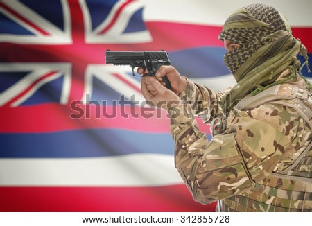 Male in muslim keffiyeh with gun in hand and flag on background series - Hawaii