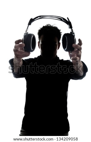 Male in silhouette showing headphones isolated on white background - stock photo