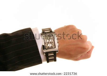male in suit wearing a stylish wrist watch business concept shot:time