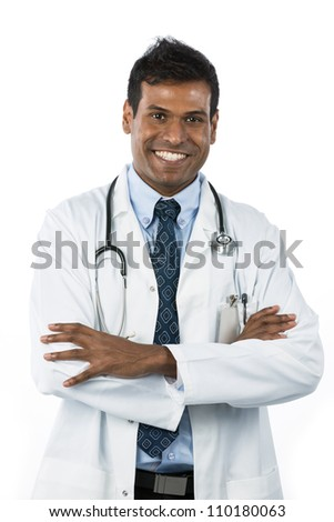 Male Indian doctor wearing a white coat and stethoscope. Isolated on white background.