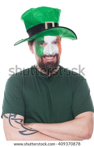 male irish soccer fan with hat looks happy, isolated on white - stock photo