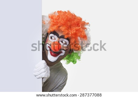 Male joker performing on white background