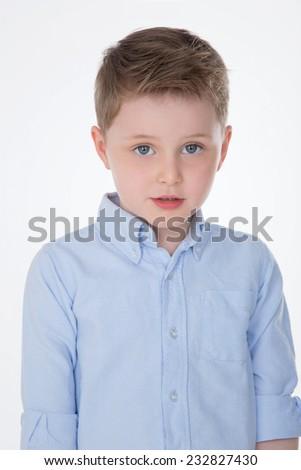 male kid posing in studio for commercial spot - stock photo