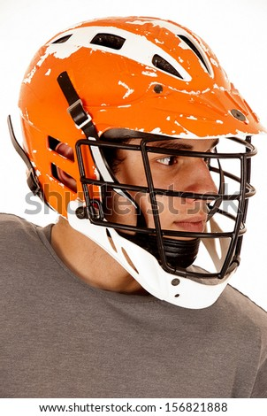 male lacrosse player close up with helmet - stock photo
