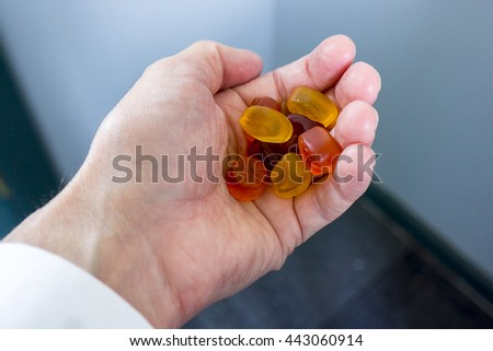 Male left hand holding fruit snacks