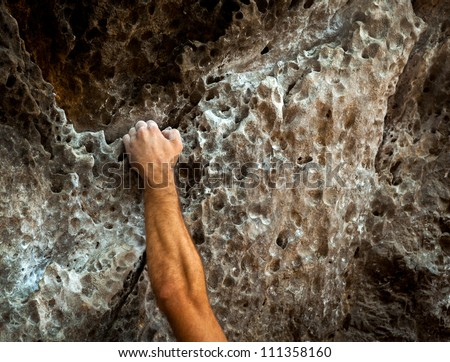 male left hand with chalk powder in cliff climbing sport, Ao Nang, Krabi, Thailand. - stock photo