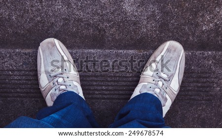 male legs and shoes top view - stock photo