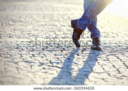 Male Legs In Denim Jeans And Leather Boots Outdoor. Fashion Street Photo. - stock photo
