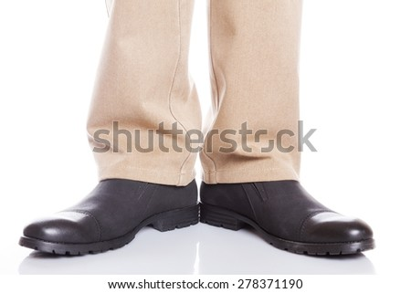 male legs in jeans and shoes on white background - stock photo