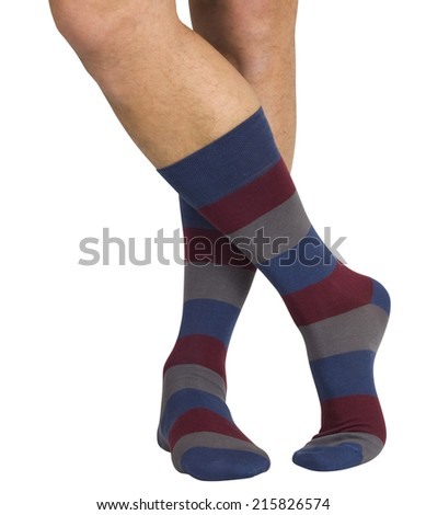 Male legs in socks. Isolated on a white background - stock photo