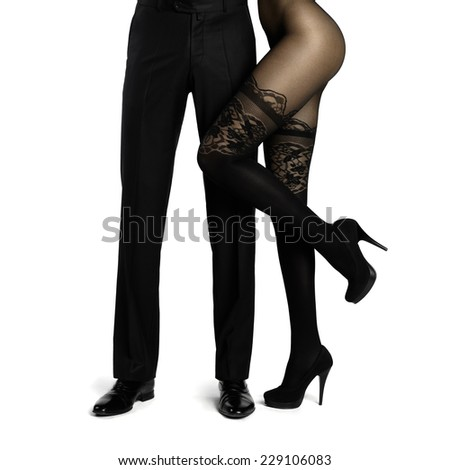 Male legs surrounded by woman. Conceptual fashion art photo isolated on white