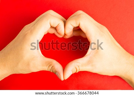 Male make  hands heart on valentine day.