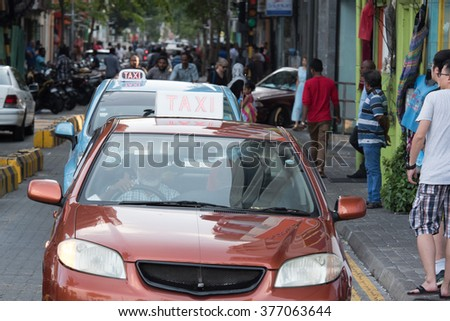 MALE, MALDIVES - FEBRUARY, 13 2016 - People in the street before evening pray time in male maldives capital small island town heavy traffic jam