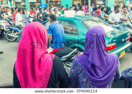 MALE, MALDIVES - MARCH 7, 2015: Locals and tourists along city streets. With a population of 150,000 Male is the capital of Maldives.