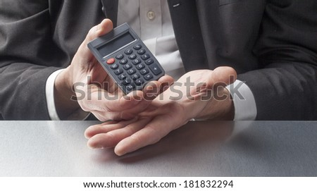 male manager displaying symbol of cost savings - stock photo