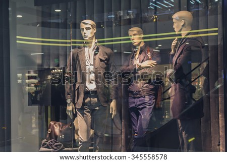 Male mannequin in a shop window. Fashion and sales - stock photo