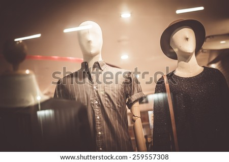 Male mannequins inside a fashion house, Color Effect - stock photo
