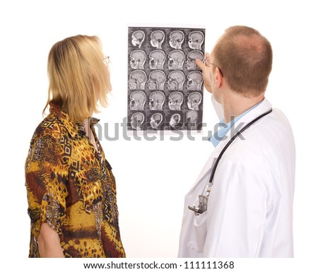 Male medical doctor examining a female patient - stock photo