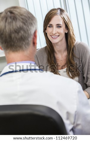 Male medical doctor seeing happy smiling female patient or colleague - stock photo