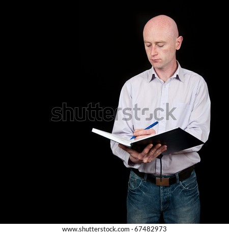 male middle age professional writting into diary