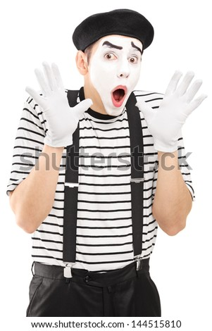 Male mime artist gesturing with his hands excitement, isolated on white background - stock photo