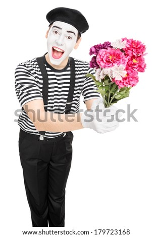 Male mime artist holding a bouquet of flowers isolated on white background - stock photo