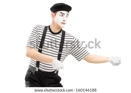 Male mime artist performing pulling virtual rope isolated on white background - stock photo