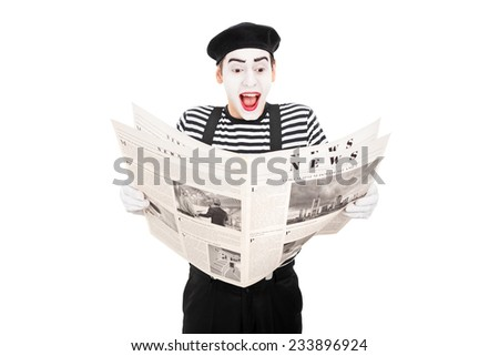 Male mime artist reading the news isolated on white background - stock photo