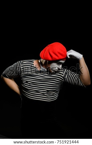 Male mime thinking and leaning on imaginary object. Professional actor showing a pantomime, imitating being in deep thought.