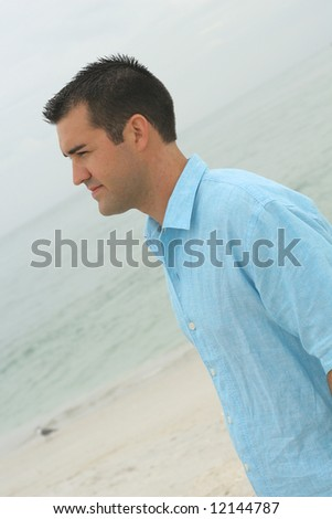 male model at the beach side angle
