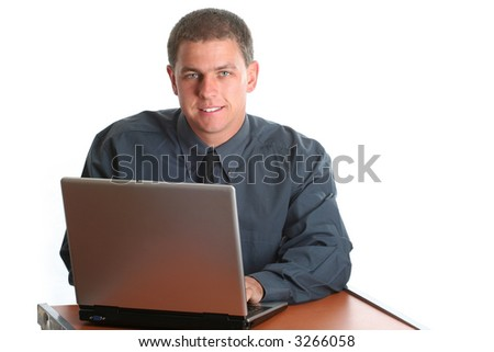 Male model behind laptop ready to assist - stock photo
