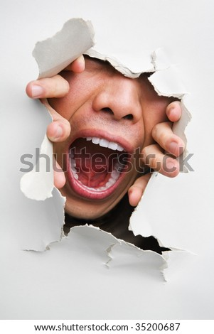 Male mouth screaming from cracked wall - one of the breakthrough series - stock photo