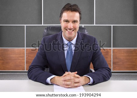 male news anchor or reporter in a studio set  - stock photo