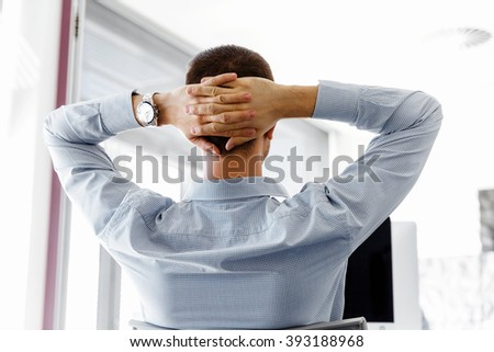 Male office worker sitting at desk - stock photo