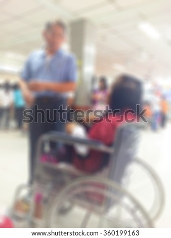 Male officer in hospital sliding wheels chair in out patient department of the hospital