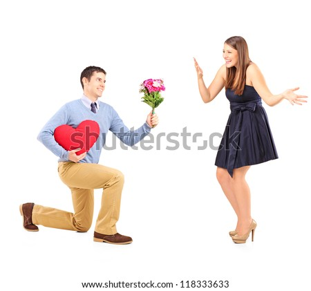 Male on knee giving a bouquet of flowers to his excited girlfriend isolated on white background