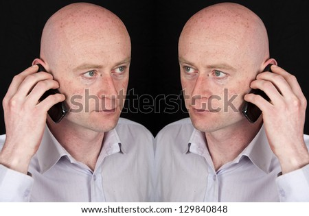 male on phone on black isolation - stock photo