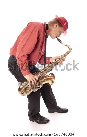 Male performer playing a brass tenor saxophone in bird view