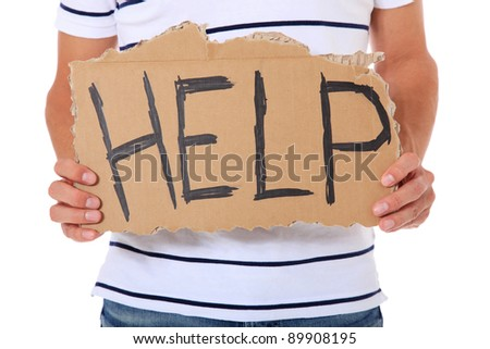 Male person holding cardboard sign with the term help. All on white background. - stock photo
