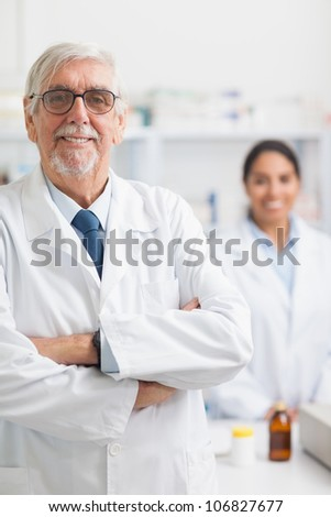Male pharmacist looking at camera in hospital